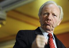 FILE - This Dec. 10, 2012 file photo, then U.S. Sen. Joseph Lieberman, I-Conn. gestures during a news conference at the state capitol in Hartford, Conn. Lieberman, who represented Connecticut in the U.S. Senate between 1989 and 2013, has been appointed a professor at Yeshiva University for the coming school year. (AP Photo/Jessica Hill, File)