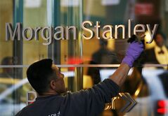 FILE - In this Jan. 19, 2010 file photo, a window washer cleans off the lettering at Morgan Stanley headquarters, in New York. Morgan Stanley reports quarterly financial results on Thursday, July 17, 2014. (AP Photo/Mark Lennihan, File)
