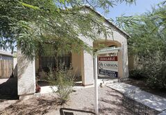 FILE - In this Tuesday, July 30, 2013, file photo, a realty sign hangs in front of a home for sale in Gilbert, Ariz .Standard & Poor's Case-Shiller reports on home prices in July on Tuesday, Sept. 24, 2013. (AP Photo/Matt York, File)