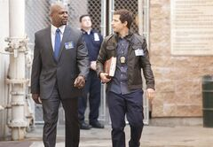 This image released by Fox shows Terry Crews, left, and Andy Samberg in a scene from