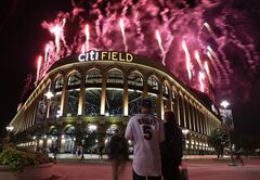 New York Mets fans watch a display of fireworks outside Citi Field afer a baseball game against the Texas Rangers, Friday, July 4, 2014, in New York. The Mets won 6-5. (AP Photo/Julie Jacobson)