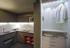 Wardrobes hidden in closets, a foldaway table and under-the-counter appliances all help to make a 325 square foot model apartment seem roomy at an exhibit called