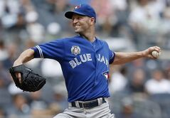 Toronto Blue Jays starting pitcher J.A. Happ delivers in the second inning of a baseball game against the New York Yankees at Yankee Stadium in New York, Sunday, July 27, 2014. (AP Photo/Kathy Willens)