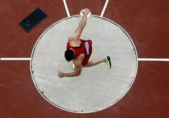 United States' Lance Brooks competes in the men's discus qualification during athletics competitions at the 2012 Summer Olympics at the Olympic Stadium in London on Monday, Aug. 6, 2012. (AP Photo/Pawel Kopczynski, Pool)
