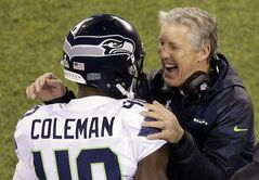 Seattle Seahawks head coach Pete Carroll laughs with Derrick Coleman (40) during the second half of the NFL Super Bowl XLVIII football game against the Denver Broncos Sunday, Feb. 2, 2014, in East Rutherford, N.J. (AP Photo/Charlie Riedel)