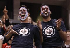 Fans of the Winnipeg Jets have fun during first period NHL action in Ottawa Thursday.