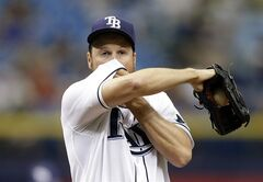 Tampa Bay Rays starting pitcher Erik Bedard reacts as he struggles during the first inning of a baseball game against the Minnesota Twins Thursday, April 24, 2014, in St. Petersburg, Fla. (AP Photo/Chris O'Meara)