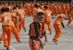 FILE - In this June 27, 2009 file photo, inmates at the Cebu Provincial Detention and Rehabilitation Center on the island province of Cebu in central Philippines dance to the late Michael Jackson's