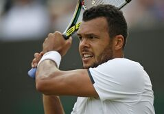 Jo-Wilfried Tsonga of France watches a return to Sam Querrey of the U.S. during their men's singles match at the All England Lawn Tennis Championships in Wimbledon, London, Wednesday, June 25, 2014. (AP Photo/Pavel Golovkin)