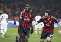 AC Milan defender Cristian Zapata, left, of Colombia, celebrates with his teammate defender Daniele Bonera after scoring during the Serie A soccer match between AC Milan and Roma at the San Siro stadium in Milan, Italy, Monday, Dec. 16, 2013. (AP Photo/Antonio Calanni)