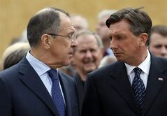 Russia's foreign minister Sergey Lavrov, left, and Slovenia's President Borut Pahor look at each other in Maribor, Slovenia, Tuesday, July 8, 2014, during the opening ceremony for a museum commemorating WWII camp for captured Soviet prisoners of war. (AP Photo/Darko Bandic)