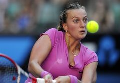 Petra Kvitova of the Czech Republic returns to Luksika Kumkhum of Thailand during their first round match at the Australian Open tennis championship in Melbourne, Australia, Monday, Jan. 13, 2014. (AP Photo/Andrew Brownbill)