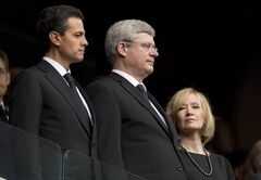 Canadian Prime Minister Stephen Harper and his wife Laureen stand next to Mexican President Enrique Pena Nieto Tuesday December 10, 2013 in Johannesburg, South Africa, during the memorial to Nelson Mandela. THE CANADIAN PRESS/Adrian Wyld