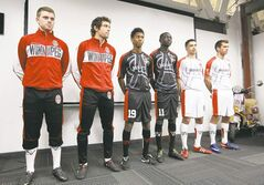 Tyson Farago (left) and his teammates on the WSA soccer team unveil their new uniforms Thursday for the 2012 season.