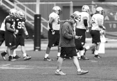 Bombers coach Tim Burke keeps his head down at practice on Wednesday.