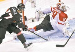 Canadian forward Jeff Carter puts one past Austrian goaltender Bernhard Starkbaum in the second period in a round-robin game Friday in Sochi. The Canadians easily dominated.