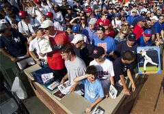 Fans crowd into the lower seating as many of them look for a autograph opportunity from New York Yankees' Derek Jeter as the team works out before a baseball game against the Texas Rangers, Monday, July 28, 2014, in Arlington, Texas. (AP Photo/Tony Gutierrez)
