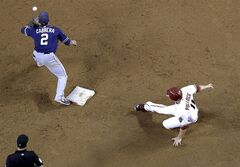 Arizona Diamondbacks' A.J. Pollock slides into second on a fly out by Gerardo Parra as San Diego Padres Everth Cabrera (2) waits for the throw during the third inning of a baseball game, Tuesday, May 27, 2014, in Phoenix. (AP Photo/Matt York)