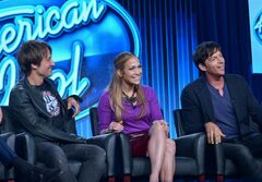 FILE - In this Jan. 13, 2014 file photo, judges, from left, Keith Urban, Jennifer Lopez, and Harry Connick Jr. are seen during the panel of