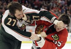 Minnesota Wild's Cody Almond (27) fights with Chicago Blackhawks' Andrew Shaw (65) during the second period of an NHL hockey game in Chicago, Sunday, April 1, 2012. The Wild have signed forward Almond to a one-year contract. THE CANADIAN PRESS/AP Photo/Nam Y. Huh