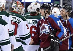 Colorado Avalanche center Nathan MacKinnon (29) greets Minnesota Wild goalie Ilya Bryzgalov (30) of Russia following Game 7 of an NHL hockey first-round playoff series in Denver on April 30, 2014. Like Sidney Crosby in 2006, Nathan MacKinnon will get a taste of Team Canada at the world championships at the age of 18. MacKinnon was one of three players added to Canada's worlds roster Sunday, along with Brayden Schenn and Matt Read of the Philadelphia Flyers. THE CANADIAN PRESS/AP, Jack Dempsey