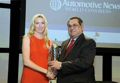 In this photo taken Wednesday, Jan. 11, 2012, and released by BorgWarner, Susie Wheldon, left, widow of IndyCar driver Dan Wheldon, accepts the BorgWarner Championship Drivers' Trophy on her late husband�s behalf from BorgWarner chief executive Timothy Manganello at a ceremony in Detroit during the Automotive World Congress. Dan Wheldon, a two-time Indianapolis 500 winner, was killed in a 15-car accident in the opening laps of the Oct. 16, 2011, IndyCar season finale at Las Vegas Motor Speedway. (AP Photo/BorgWarner, Patrick R. Bafile)