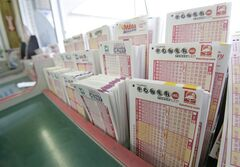 Powerball tickets, right, along with other lotto tickets are seen Thursday, May 16, 2013, at a convenience store in Orlando, Fla. The prize estimated around $475 million is the third largest in lottery history, and the winning numbers will be drawn on Saturday.(AP Photo/John Raoux)