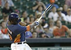 Houston Astros' Chris Carter breaks his bat as he grounds out against the Seattle Mariners in the sixth inning of a baseball game Sunday, May 4, 2014, in Houston. (AP Photo/Pat Sullivan)