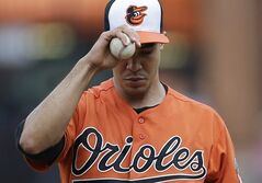 Baltimore Orioles starting pitcher Ubaldo Jimenez pauses after walking Cleveland Indians' Michael Bourn to load the bases in the fifth inning of a baseball game, Saturday, May 24, 2014, in Baltimore. (AP Photo/Patrick Semansky)