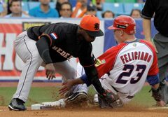 Yurendell de Caster, standing, has played for the Netherlands in the 2008 Summer Olympics and at the 2006 and 2009 World Baseball Classic tournaments.