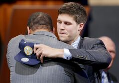 Creighton's Doug McDermott, right, is congratulated after being selected 11th overall by the Denver Nuggets during the 2014 NBA draft, Thursday, June 26, 2014, in New York. (AP Photo/Jason DeCrow)
