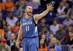 Minnesota Timberwolves guard Jose Barea yells to his bench against the Phoenix Suns during the first half of an NBA basketball game, Tuesday, Feb. 25, 2014, in Phoenix. (AP Photo/Matt York)