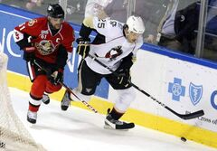 Eric Tangradi (right) has been acquired from the Pittsburgh Penguins by the Winnipeg Jets in exchange for a seventh-round pick in the 2013 NHL entry draft.