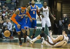 Milwaukee Bucks' Ersan Ilyasova is fouled by New York Knicks' Carmelo Anthony during the first half of an NBA basketball game, Monday, Feb. 3, 2014, in Milwaukee. (AP Photo/Tom Lynn)