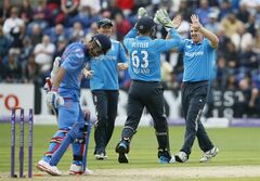 England's bowler James Tredwell, right, celebrates with his team mates and wicketkeeper Jos Buttler who stumped out India's Ajinkya Rahane, left, during their One Day International cricket match at the SWALEC cricket ground in Cardiff, Wales, Wednesday, Aug. 27, 2014. (AP Photo/Alastair Grant)