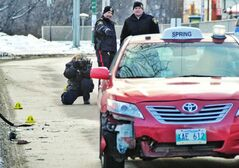 Police at accident scene on New Year's Day.