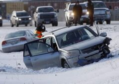 A head-on collision involving at least three cars was blocking Plessis Road south of Dugald Road this morning, putting two cars in the ditch. Plessis was among many streets iced over causing headaches for motorists in the morning rush hour.