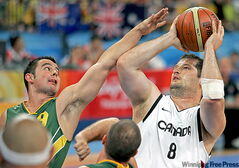 Joey Johnson (right) plays Australia's Tristan Knowles at the Beijing Olympics.