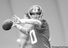 New York Giants QB Eli Manning throws during practice Wednesday in Indianapolis. Manning has been dynamite in fourth quarters this season.