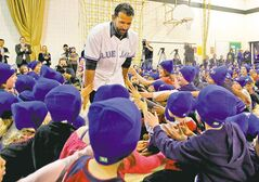 Students at École Van Walleghem School in Linden Woods mob Toronto Blue Jays slugger José Bautista Monday morning as he and three teammates visit.
