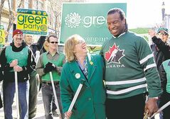 Green Party Leader Elizabeth May and Georges Laraque ham it up during a campaign stop in Calgary on April 19, 2011.