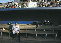 Photos by Jessica Hill / The Associated Press files