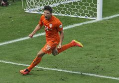 Netherlands' Klaas-Jan Huntelaar celebrates after scoring his side's second goal from the penalty spot during the World Cup round of 16 soccer match between the Netherlands and Mexico at the Arena Castelao in Fortaleza, Brazil, Sunday, June 29, 2014. Holland won 2-1 and advanced to the quarterfinal. (AP Photo/Themba Hadebe)