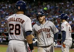 Houston Astros' Jon Singleton (28) congratulates Robbie Grossman (19) on Grossman's solo home run off of Texas Rangers starting pitcher Yu Darvish as George Springer (4) prepares for his at bat in the fifth inning of a baseball game, Wednesday, July 9, 2014, in Arlington, Texas. (AP Photo/Tony Gutierrez)