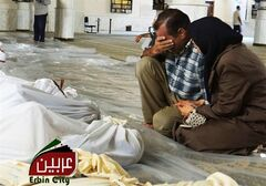 In this citizen journalism image provided by the Local Committee of Arbeen, which has been authenticated based on its contents and other AP reporting, a man and woman mourn over the dead bodies of Syrian men after an alleged poisonous gas attack fired by regime forces, according to activists in Arbeen town, Damascus, Syria, Wednesday, Aug. 21, 2013. Syrian regime forces fired intense artillery and rocket barrages Wednesday on the eastern suburbs of the capital Damascus, in what two pro-opposition groups claimed was a