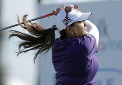 Lizette Salas of the U.S. tees off during the last day of the LPGA Pure Silk Bahamas at the Classic Ocean Club Golf Course, Paradise Island, Bahamas, Sunday, Jan. 26, 2014. (AP Photo/Tim Aylen)