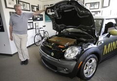 Dirk Rossberg, head of BMW's Group Technology Office shows off an electric Mini E at the company's research lab  in Mountain View, California.
