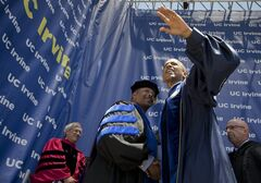 President Barack Obama, waves to the after delivering his commencement address to the graduates of University of California, Irvine, at the Angel Stadium of Anaheim in Anaheim, Calif., Saturday, June 14, 2014. (AP Photo/Manuel Balce Ceneta)