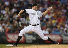 Colorado Rockies starting pitcher Tyler Matzek works throws to a Pittsburgh Pirates batter in the fourth inning of a baseball game in Denver on Saturday, July 26, 2014. (AP Photo/David Zalubowski)