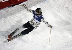 Aaron Blunck skids to a stop after completing his second run during the World Cup U.S. Grand Prix halfpipe freestyle skiing finals, Friday, Dec. 20, 2013, in Frisco, Colo. (AP Photo/Julie Jacobson)